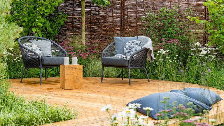 Raised by rivers garden designed by Nicola Oakey for RHS Tatton Park flower show 2018 with woven cheap fence ideas