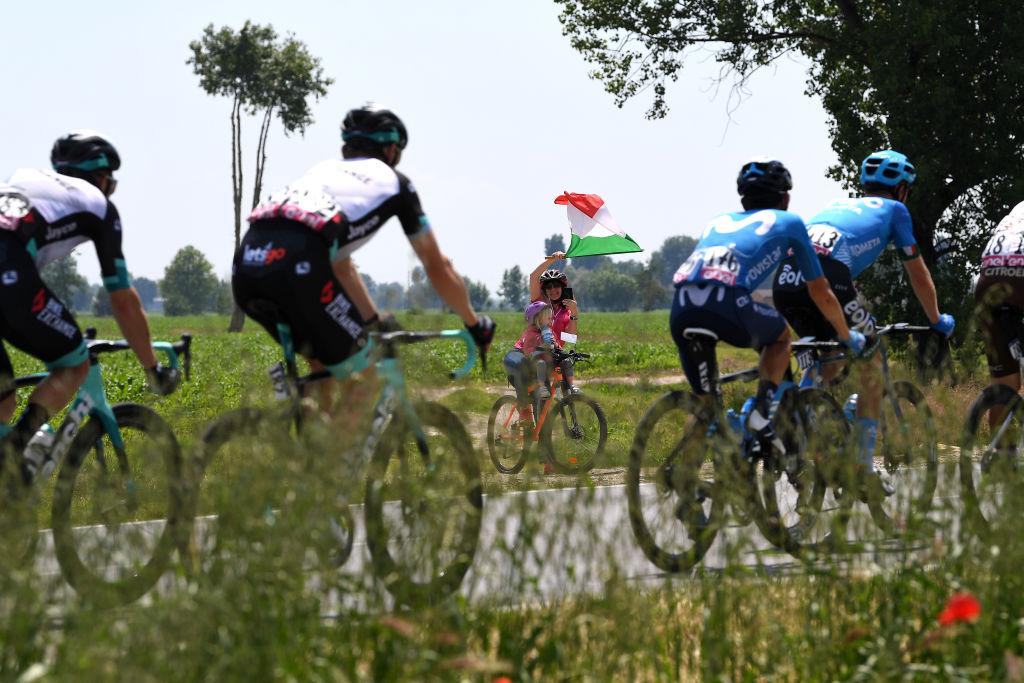 STRADELLA ITALY MAY 27 Fans cheering The Peloton during the 104th Giro dItalia 2021 Stage 18 a 231km stage from Rovereto to Stradella Children Bike Italian Flag UCIworldtour girodiitalia Giro on May 27 2021 in Stradella Italy Photo by Tim de WaeleGetty Images