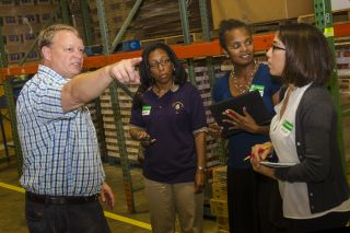 Researchers visit a food bank
