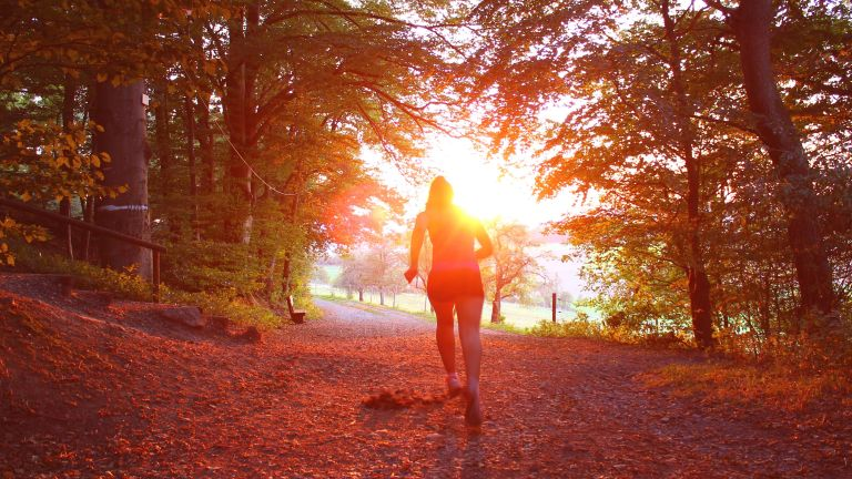 Woman running sunshine vitamin D