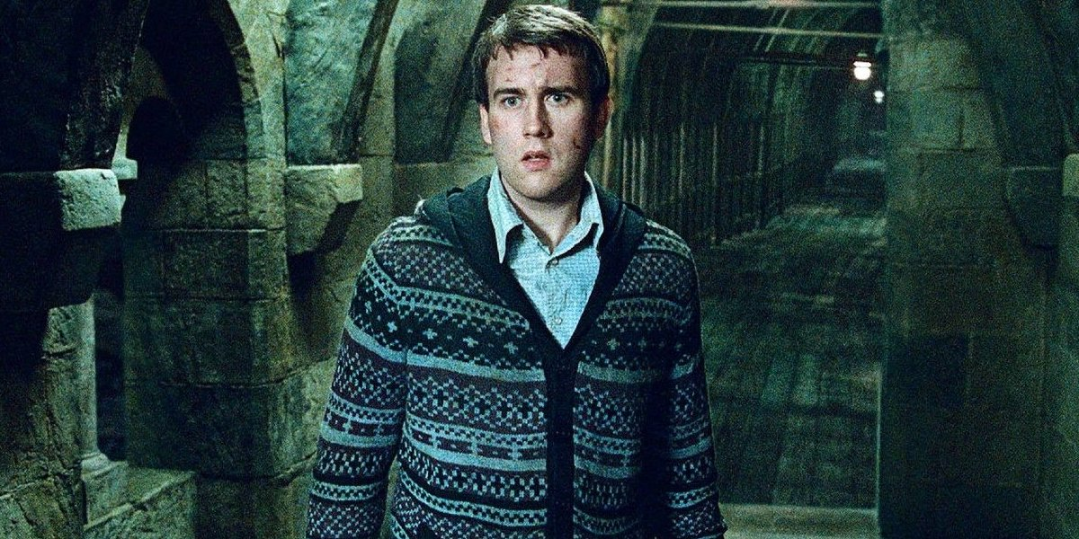 Matthew Lewis standing in a hallway in Harry Potter and the Deathly Hallows: Part 2.