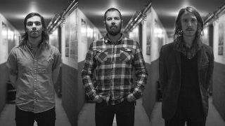 Russian Circles black and white band shot in a corridor