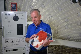 Steve Lindsey, Vice President of Space Exploration Systems, Sierra Nevada Corp. and former NASA astronaut, shows compact garbage