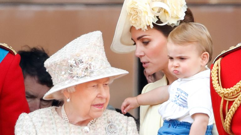 Prince Louis birthday photo, Queen Elizabeth II, Catherine, Duchess of Cambridge and Prince Louis of Cambridge watch a flypast from the balcony of Buckingham Palace during Trooping The Colour, the Queen's annual birthday parade, on June 8, 2019 in London, England