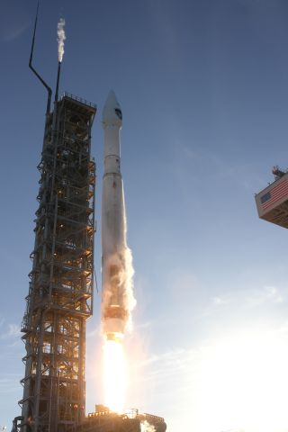 A United Launch Alliance Atlas 5 rocket carrying the Air Force's DMSP-19 military weather satellite lifts off from Space Launch Complex-3 at Vandenberg Air Force Base, Calif., on April 3, 2014.