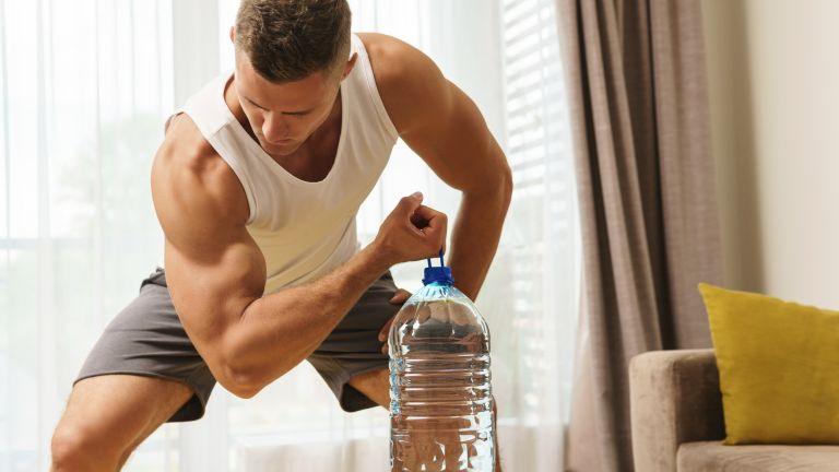 Man using a water bottle as a weight