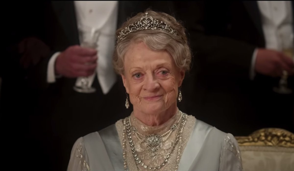 Downton Abbey Violet the Dowager Countess smiles while in her finery