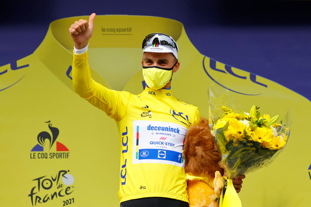 Team Deceuninck Quicksteps Julian Alaphilippe of France celebrates his overall leaders yellow jersey on the podium at the end of the 1st stage of the 108th edition of the Tour de France cycling race 197 km between Brest and Landerneau on June 26 2021 Photo by Thomas SAMSON POOL AFP Photo by THOMAS SAMSONPOOLAFP via Getty Images