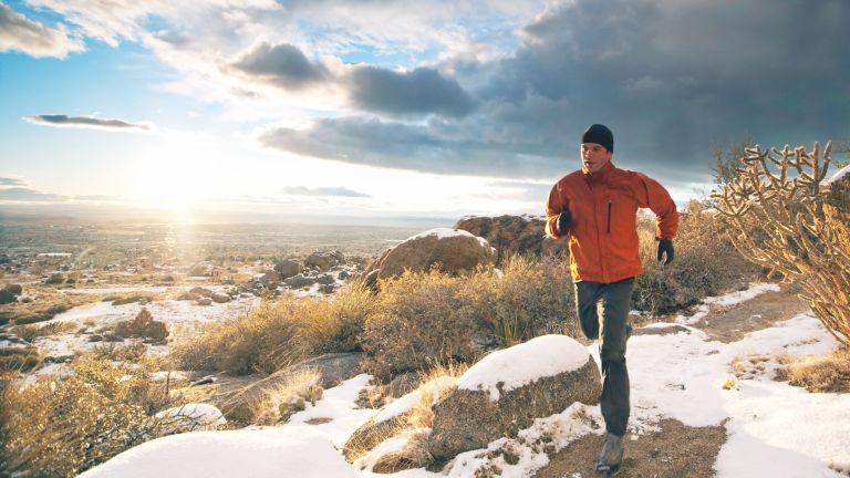 Man trail running in winter