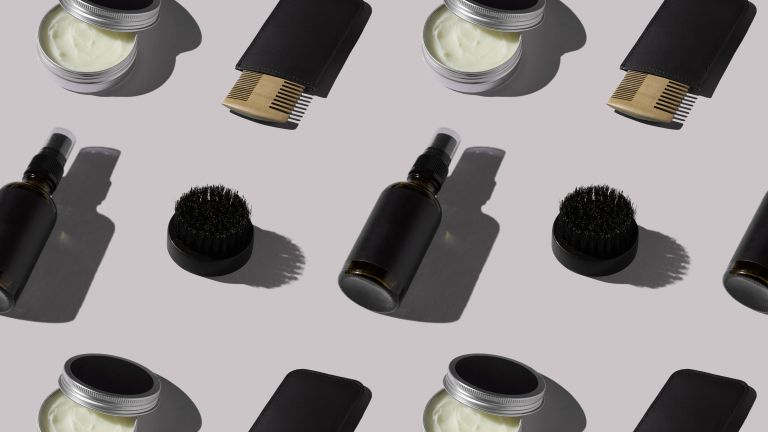 Beard oil bottles and combs in an abstract a pattern on a grey background