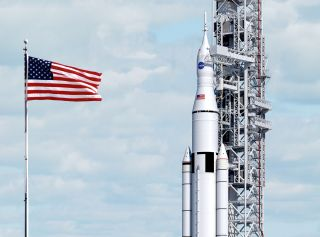An artist's illustration of NASA's huge Space Launch System rocket at the launchpad with an Orion space capsule.