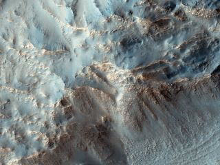 Dark Streaks Indicate Water on Mars