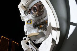 NASA astronaut Scott Kelly is seen during his first spacewalk outside the International Space Station on Oct. 28, 2015. Kelly and crewmate Tim Kopra will make a 3-hour spacewalk today (Dec. 21) to fix a stuck railcar on the station.