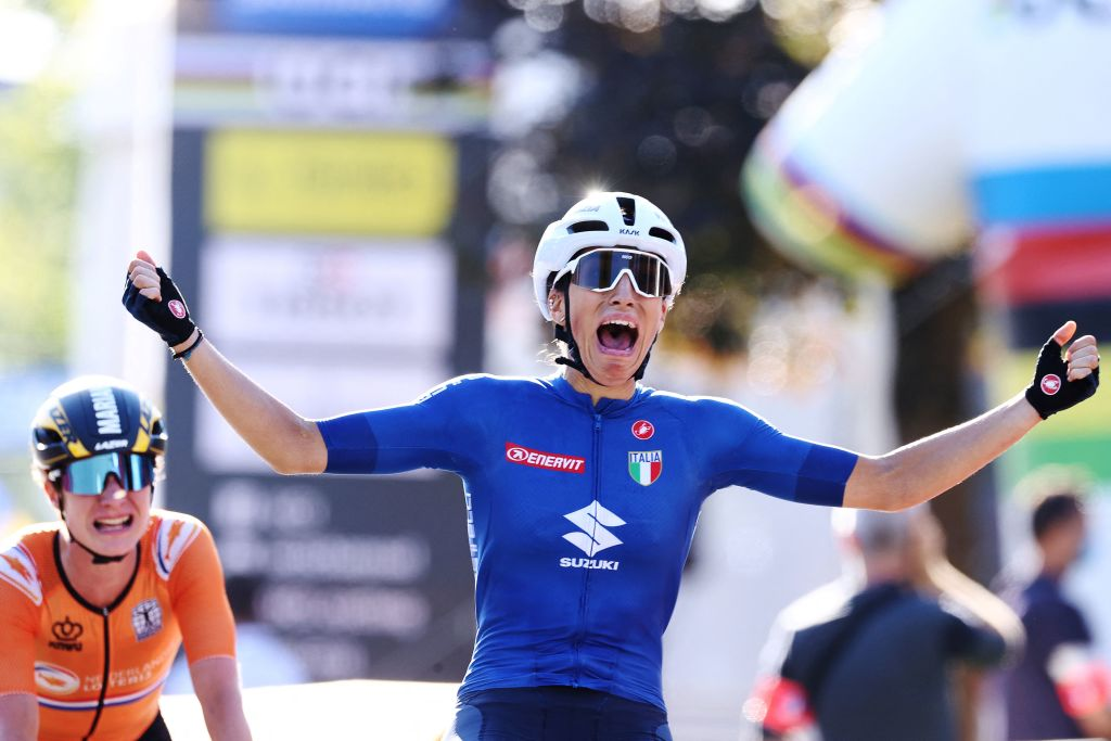 Italys Elisa Balsamo R celebrates as she crosses the finish line to win ahead of secondplaced Netherlands Marianne Vos during the womens elite cycling road race 1577km from Antwerp to Leuven on the seventh day of the Flanders 2021 UCI Road World Championships on September 25 2021 in Leuven Photo by KENZO TRIBOUILLARD AFP Photo by KENZO TRIBOUILLARDAFP via Getty Images