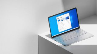 Laptop running Windows 11 sitting on an off-white table