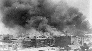 Buildings on fire in Tulsa, Oklahoma during the 1921 Tulsa race massacre