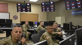 100th Missile Defense Brigade National Guard soldiers operate missile warning satellites at Schriever Air Force Base, Colorado.