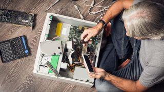 Older Man Assembling PC