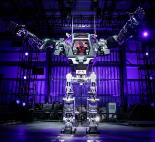 """Amazon CEO Jeff Bezos piloted a giant """"mech"""" robot at the 2017 Machine Learning, Home Automation, Robotics and Space Exploration (MARS) conference."""