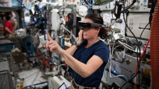 NASA astronaut Megan McArthur testing a virtual reality headset during experiments at the International Space Station.