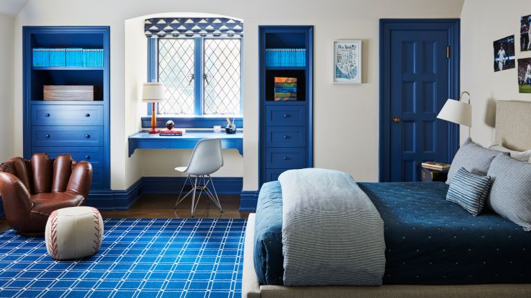 Bedroom ideas for boys: A child's bedroom with white wall, blue painted accents and a chair shaped like a baseball mit
