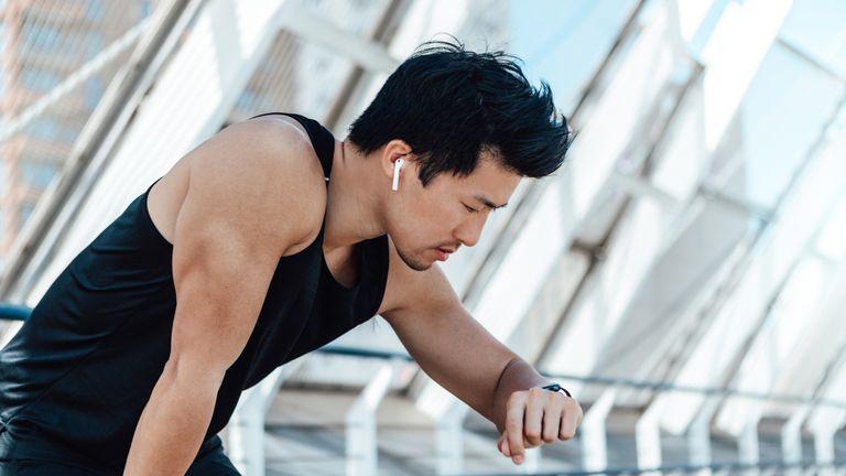 Man checking smartwatch during a run