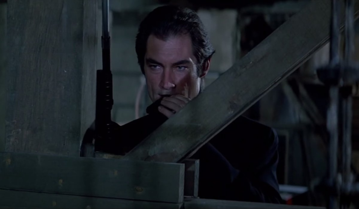 License To Kill Timothy Dalton prepares to take a shot from cover