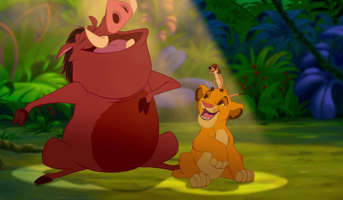 Pumbaa, Timon and Simba during Hakuna Matata scene in The Lion King