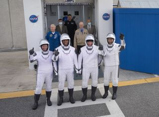 NASA's Crew-1 astronauts pose for a photo as they prepare to head to Pad 39A for their SpaceX Crew Dragon launch on Nov. 15, 2020. They are (from left): NASA astronauts Shannon Walker, Victor Glover, Mike Hopkins and Soichi Noguchi with the Japan Aerospace Exploration Agency.