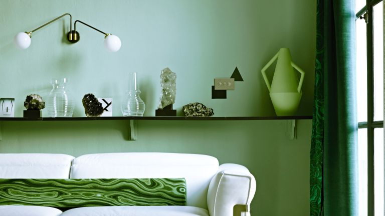 Interior designers favorite shade of green paint, living room with sofa and green walls