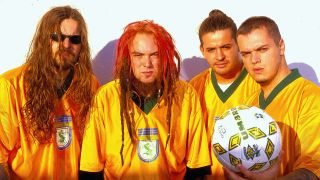 A press shot of Sepultura in Brazil football kits
