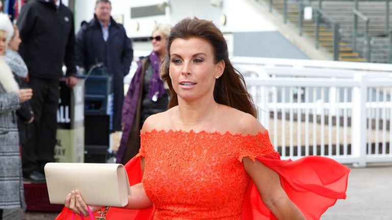 Coleen Rooney attends day 1 'Grand Opening Day' of the Crabbie's Grand National Festival at Aintree Racecourse on April 7, 2016 in Liverpool, England.