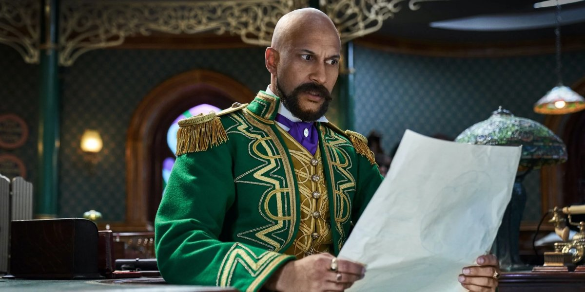 Keegan-Michael Key as Gustafson looking over his blueprints in Jingle Jangle.