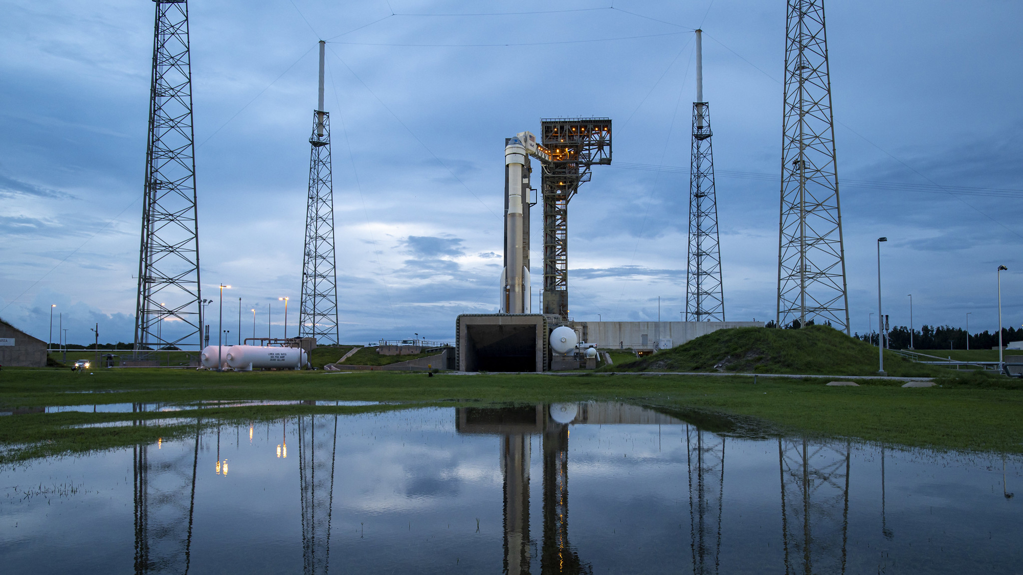 The United Launch Alliance Atlas V rocket and Boeing's Starliner spacecraft sit on Space Launch Complex 41 at Cape Canaveral Space Force Station at sunset on Aug. 2, 2021 for the OFT-2 mission to the International Space Station.