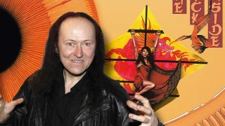 Cronos standing in front of the art for Kate Bush's The Kick Inside