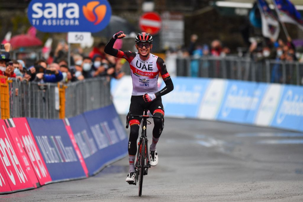 Team UAE Emirates rider US Joe Dombrowski celebrates as he crosses the finish line to win the fourth stage of the Giro dItalia 2021 cycling race 187 km between Piacenza and Sestola EmiliaRomagna on May 11 2021 Photo by Dario BELINGHERI AFP Photo by DARIO BELINGHERIAFP via Getty Images