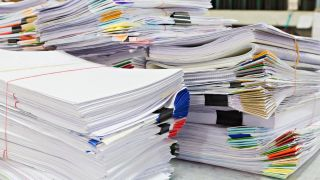 Online Faxes - a pile of paper faxes