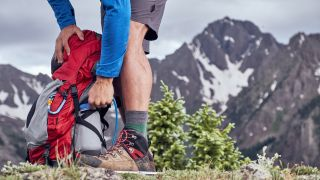best daypacks: hiker with daypack