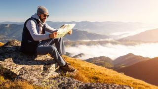 how to read a map: hiker reading map