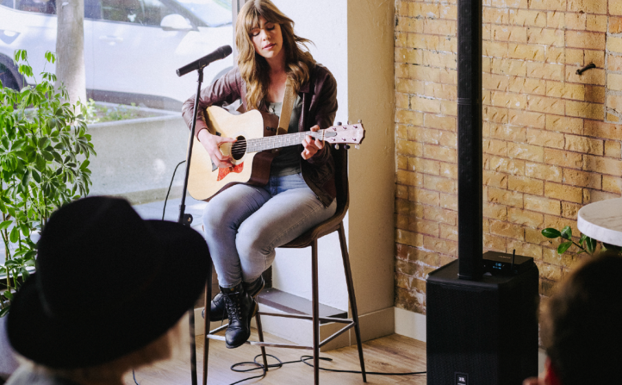Guitarist plays show at cafe next to PRX ONE