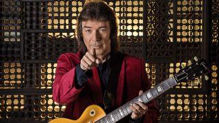 Steve Hackett holding a guitar