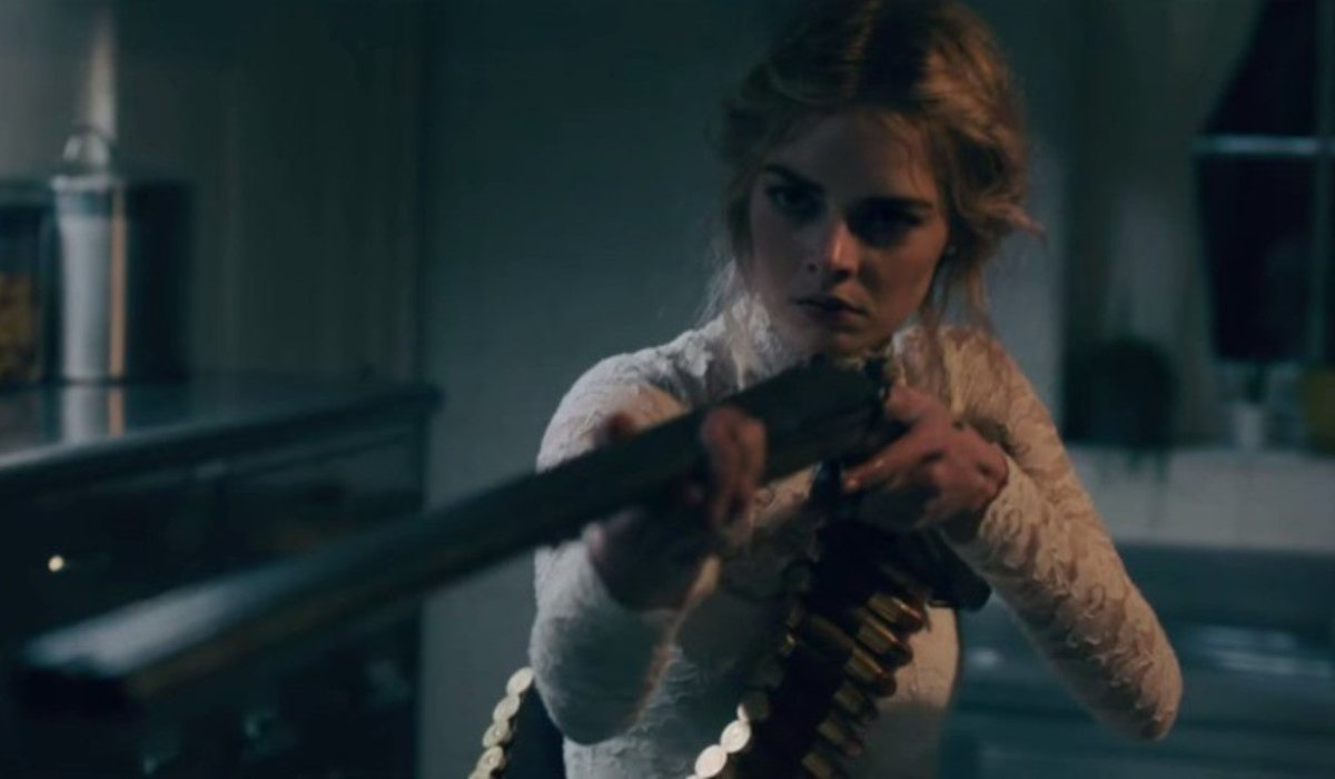 Ready Or Not Samara Weaving aiming a shotgun close to the camera