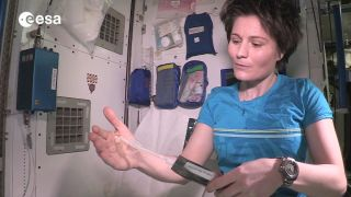 Cristoforetti Demonstrates Showering in Space