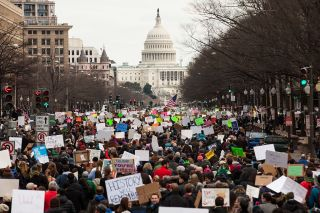 Demonstrators march down Pennsylvania Avenue during a protest of President Trump's travel ban on Jan. 29, 2017 in Washington, D.C.