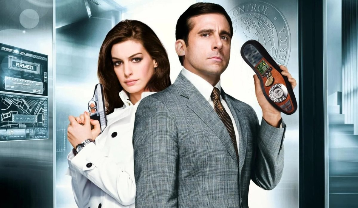 Get Smart Anne Hathaway and Steve Carell, ready with a gun and a shoe phone