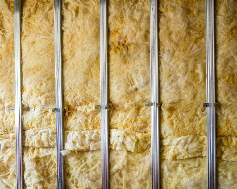 sustainable home improvements - rockwool insulation installed in home - GettyImages-1060518474