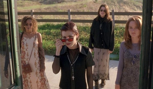 The Craft witches trying to get on a bus near a farm