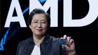 AMD CEO Dr. Lisa Su holding a Ryzen processor.