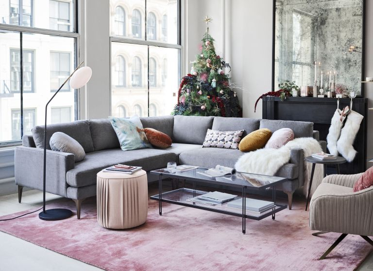 grey corner sofa in a living room with a Christmas tree