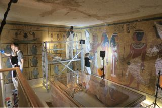 Conservators and archaeologists complete conservation work of the wall paintings in the burial chamber of King Tut's tomb in the spring of 2016.